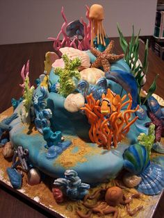 A true work of art! So many intricate pieces of coral, shells & fish on this cake. Beautifully done scuba reef.