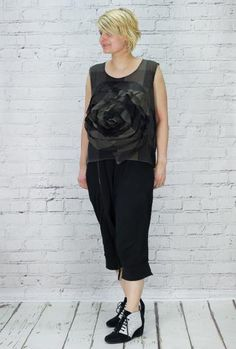 Moyuru sleeveless top with rose shape appliquéd on the front. Gossamer light, no fastenings, wear it over a tighter top or dress. Woven pure cotton, handwashable. Worn with Rundholz harem trousers