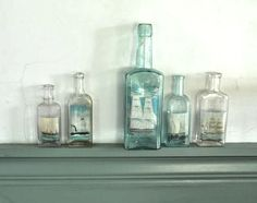 Decorating with Bottles. Pictures of Ships in Bottles! http://www.completely-coastal.com/2012/07/sea-bottle-collections-some-washed.html