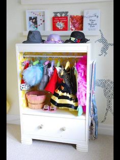 Tired of seeing your little girl's costumes and dress up clothes everywhere? Get organized by building this DIY dress up closet out of an upcycled dresser Dress Up Wardrobe, Dress Up Closet, Dress Up Outfits, Diy Dress, Doll Closet, Wardrobe Closet, Dress Up Storage, Diy Storage, Clothes Storage