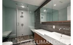 We hope those floors are heated—the stone would be cold getting out of the shower.