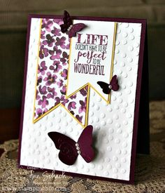 Rich Razzleberry and Basic Black Stampin' Write Markers. Being lighter in hue than Blackberry Bliss, Rich Razzleberry provides a nice constast to the black. A sprinkling of butterflies! The Beautiful Wings Embosslits were used to create a trio of butterflies to accent the banners. Of course, I could not resist the urge to add a few pearls.