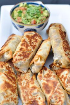 Baked and healthy Southwestern Eggrolls..these actually get crispy! Can add chicken for extra protein to make a meal. Made about 16 egg rolls!