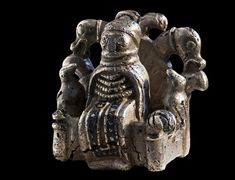 """Silver figurine of #Odin from Lejre, Denmark - circa late Iron Age / Viking Age.   """"That it is the… Æsir's supreme god who is depicted, is clearly shown by the two birds sitting on the armrests of the chair. They are Odin's two ravens, Hugin and Munin, that flew out every day and returned home in the evening to tell Odin all that had happened…."""""""