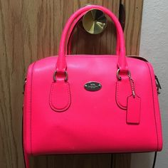 Hot pink Coach cross body purse Gently used, so please expect normal wear and tear. No stains or tears! Small purse and wonderful, bright color. I always got lots of compliments on the purse whenever I used it. No trades or Paypal. Please give me your best reasonable offer  Coach Bags Crossbody Bags