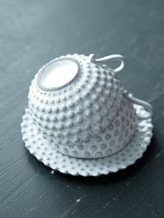 I WANT THIS CUP AND SAUCER!! found the cup info at least in their catalogue.: Astier de Villatte :: Nom Tasse  Collection Adélaïde  Dimensions (cm) 11 x 13 x 5  Référence TSSADL3