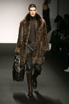 A men's fur coat with matching knee high boots.