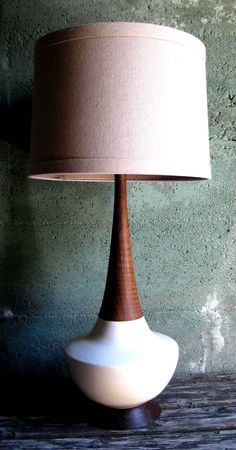 These table lamps are produced in Tacoma WA by the ceramic artist Bruce Thompson. Bruces Danish Modern inspired designs are hand thrown and trimmed