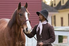 Leading a horse in the early morning at Colonial Williamsburg. Photo by David M. Doody