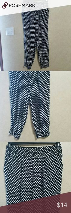 Jogger style dress pants Elastic and drawstring waist. Elastic cuffs. Cute block pattern. Excellent condition.  No stains, holes, picks, or frays.lightweught 100% polyester. Inseam about 30 inches. Elastic waist is about 15 inches across, unstretched. Zac & Rachel Pants