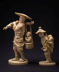 A Japanese carved ivory okimono: of a peasant with straw hat carrying a child in a basket, signed, 22.5cm. high together with another okimono of peasant with children climbing his back, signed by the same artist, 16cm. high, Meiji period, (2).