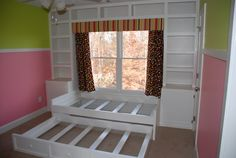 2 Daughters Share a Room, Built ins with platform bed and trundle underneath.  This would be a cool window seat that could double as extra sleep space for guest...