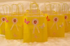 Return Gift bags with the birthday girls sticker saying 'Thankyou'.The butterfly is made from a paper punch.