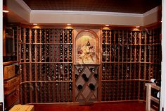 This finished basement in Delaware County, PA has a custom wine cellar that accomodates a 1,000 bottle collection. Description from spacements.com. I searched for this on bing.com/images