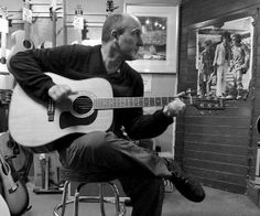DB road-testing acoustic guitars on Denmark Street. Photo by Mrs Sciencebase