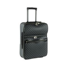 This Louis Vuitton suitcase is crafted of durable Damier Graphite canvas. This…