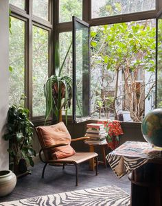 Lush reading nook. Would love to curl up here! Open windows, comfy chair and a good book.