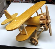 Stearman wood biplane made from yellow-heart wood made by a talented Rockler customer. Woodworking For Kids, Woodworking Supplies, Woodworking Projects, Rockler Woodworking, Wooden Toy Cars, Wooden Plane, Wood Toys Plans, Stained Glass Projects, Toy Craft
