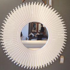 Gorgeous white Lacquer Sunburst mirror by Barclay Butera Lifestyle in Market Square.
