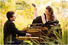 She's an opera singer and he a pianist, of course a piano in the wheat field makes since!