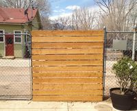 DIY privacy fence over chain link fence