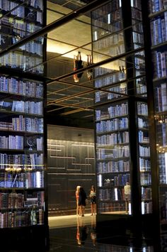 """The """"bookshelves"""" are 3d flat screens with multiple layers that change pictures. The mirrored ceiling is Vegas in a nutshell. I miss that crazy place sometimes."""