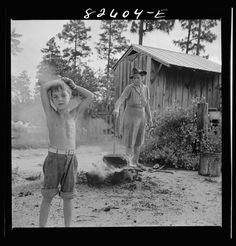 Escambia Farms, Florida. Boiling wash water on the McLelland farm, 1942