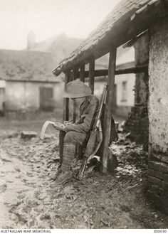 "A member of the 2nd Battalion ""carrying on"" with his correspondence."
