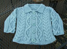 Aran Baby Cardigan in Aquarium Blue   Pattern: Aran Baby Cariganfrom McCalls Knitting Book 5 (1972)   Link to pattern PDF --> : ...