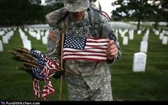 "Pvt. John Hubbard of the 3rd U.S. Infantry Regiment places American flags at the graves of soldiers at Arlington National Cemetery in the annual ""flags-in"" ritual that pays respects to the war dead for Memorial Day.    ""The legacy of heroes is the memory of a great name and the inheritance of a great example.""  - Benjamin Disraeli"