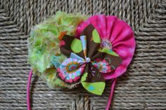 Brown birdhouse fabric petal flower with pearl accent set on frayed lime birdie puff and hot pink ruffle.  - headband - hair accessories