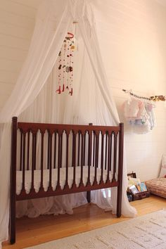 AT nursery tour- perfect trim around a crib without mounting a whole frame on the wall
