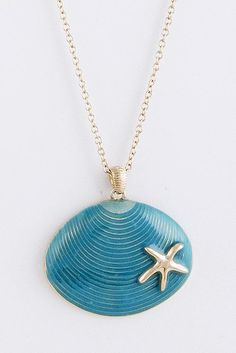 "A blue shell pendant accented with a silver starfish.30"" LengthLobster Claw Clasp with 3"" Extender"