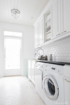 White and bright laundry room with subway tile