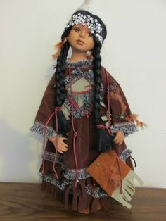 Her cloth ovaloid head has simple hand drawn features and red dots painted on the cheeks. Native American Dolls, Native American Indians, American Girl, Native Americans, Pixie, Indian Costumes, Indian Dolls, Native Indian, Girl Dolls