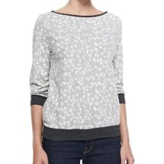 Three Dots Leopard Print Top Three Dots Leopard Print Top. 3/4 length sleeves, scoop neck, light gray/white print, dark gray band on sleeves and bottom. EUC, light pilling under arms and bands around sleeves and bottom. Light sweat shirt material, perfect with yoga pants or with jeans, bright jewelry, and heels on a date night. Three Dots Tops Sweatshirts & Hoodies