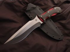 "Centurion - 7"" blade, 3/16"" thick, 12"" overall length. Serrated thumb ramp, False upper edge.  Carbon fiber over red G10 handle with stainless pins.  By Dmknives"