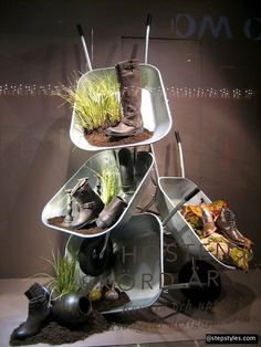 wheel barrow visual merchandising - I visualize flowers spilling out! Omg!