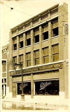 Located at 2213 Commerce Street, Dallas, Texas. This 1913 postcard of Munger Cadillac Dealership was taken by William Frank Rogers, commercial photographer in Dallas. The building still stands today. Courtesy George W. Cook collection at SMU's DeGolyer Library.