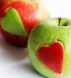 love apples. press a heart-shaped cookie cutter into two different apples, cut the hearts out with a knife, and switch.