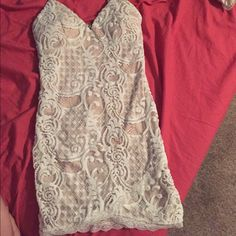 Lacy body con dress Super sexy yet classy , lace white and cream dress love this dress so much but too tight for me says size small fits like a XS/S Dresses Mini