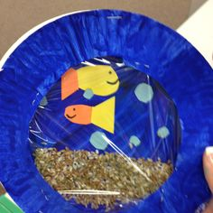 Made fish tanks out of paper plates and Saran wrap with the kids for under the sea week