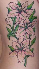 Lily rib cage tattoo