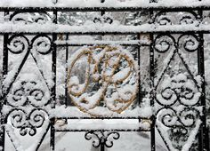 Snow covers the gates at the entrance to the Balmoral Estate at Crathie, in Scotland
