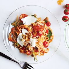 This raw tomato sauce gets texture from zucchini and body from toasted nuts that are blended into the base. You can sub almonds for hazelnuts.