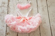 Super Fluffy and Soft pettiskirt. Matching petti top with flower embellishment. Ready for your peanut to wear to her first birthday or any over