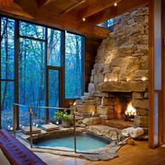 Indoor hot tub with a fireplace! We need this in our bedroom lol