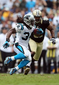 Will Smith #91 of the New Orleans Saints goes after DeAngelo Williams #34 of the Carolina Panthers during their game at Bank of America Stadium on September 16, 2012 in Charlotte, North Carolina.