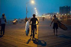 Surfer boardwalk cruise