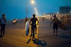 Surfer boardwalk cruise